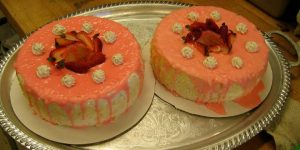 Up close shot of decorated cake desserts on a gold platter