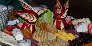 Up close shot of a custom appetizer platter with decorative garnishes