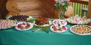 Dessert table featuring various pastries and decorative cakes set up in the dining room