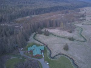 Aerial wide shot of Bear Track Inn to show winding river that goes right up to the inn