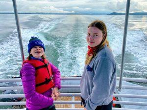Two kids on a boat tour in Alaska