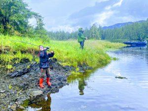 Group of people fishing in Alaskan waters