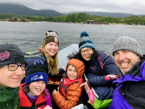 The whole family enjoying a boat ride just off the Alaskan coastline