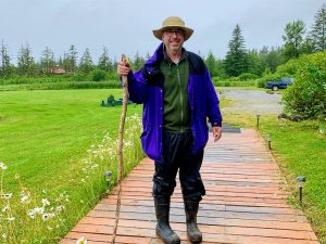Man with walking stick ready to tackle the hikes around Bear Track Inn