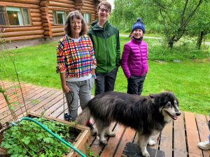 Bear Track family with canine mascot happily wagging tail by the planter box