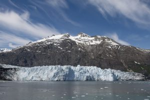 View of a large glacier and a snow-capped mountain