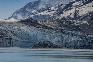 Shot of a large glacier that blends into a snow-bound mountain range