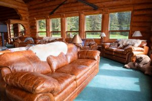 Abundant leather couches in the great room at the Bear Track Inn