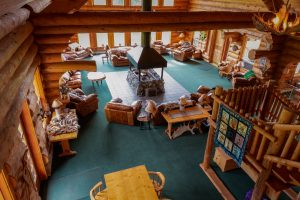 View from right side of stairs on second floor down into great room at the Bear Track Inn