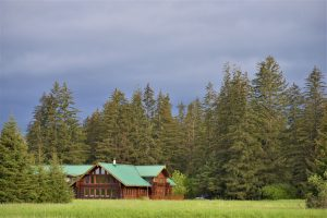 Bear Track Inn across a meadow and nestled in trees