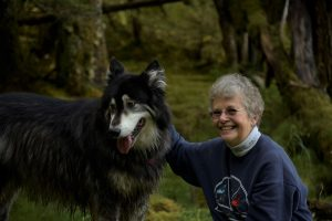 Bear Track Inn owner with dog