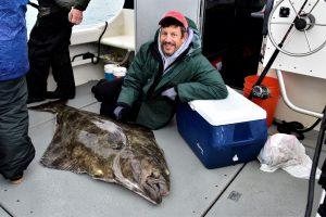Large flounder catch on boat in Alaska