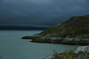 Alaskan rocky and mountainous cliffsides during an overcast day