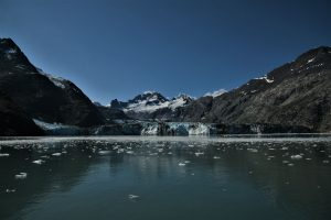 View of Alaskan glacier and mountains beyond from the water
